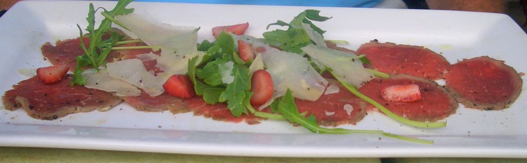 Beef carpaccio served with rocket, parmesan and strawberries – genius