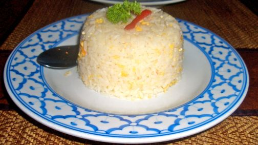 The egg fried rice is fluffy and perfectly formed
