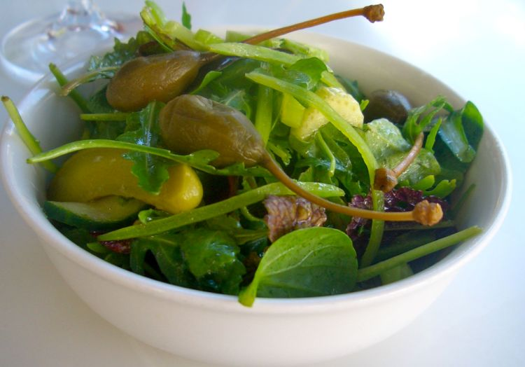 An amazing green salad with caper berries and gherkins