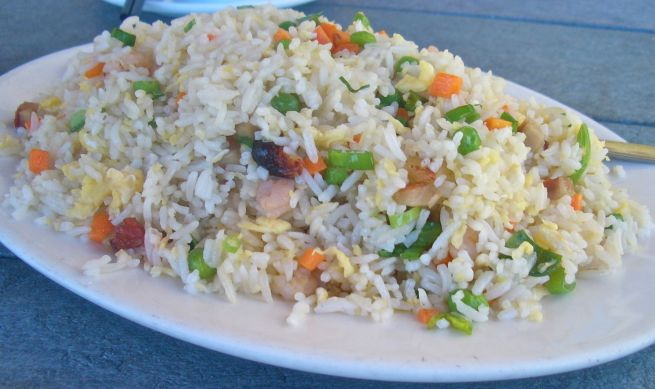 A large portion of special fried rice with plenty of tasty morsels