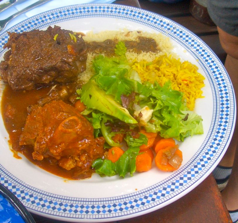 Lamb tagine and oxtail from the buffet with rice, cous cous and vegetables