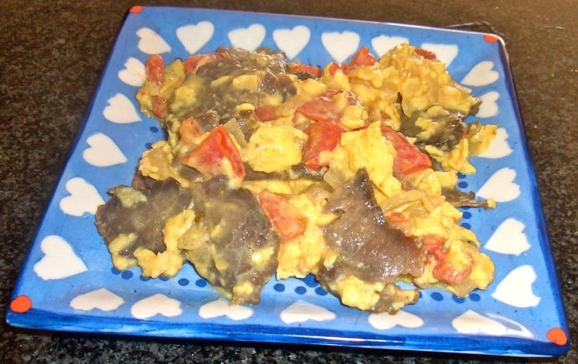 Amazing scrambled eggs with biltong, onion, tomatoes, cumin and chilli