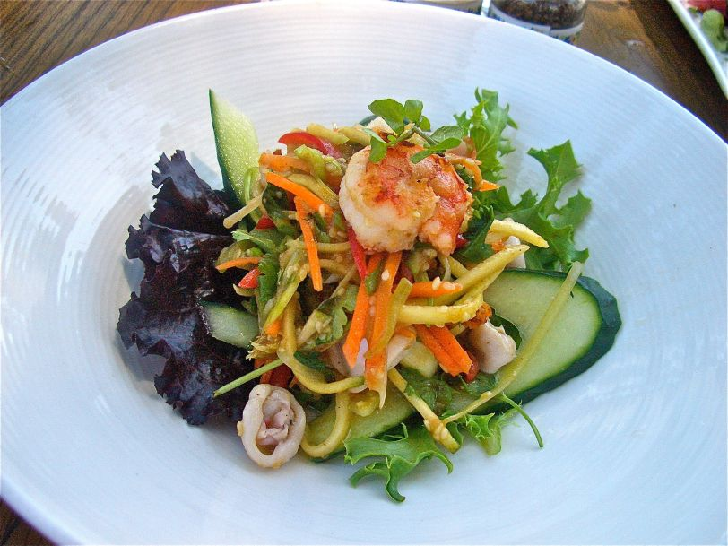 Thai prawn and calamari salad with coriander, mango and tamarind sesame dressing