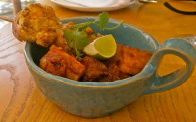 Patatas bravas with the perfect sauce and garlicky prawns