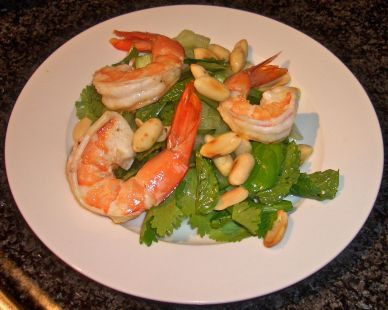 Tempting juicy prawns rest on a zesty herb bed