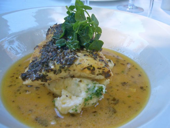 Pesce al forna con erbe aromatiche: Kingklip baked in the oven with sage, thyme, parsley, rosemary, mint, garlic, butter and white wine served with garlic and parsley mash