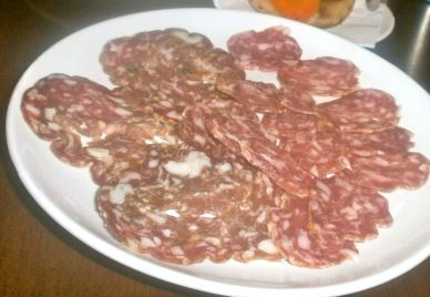 Tasty salami served with house pickles