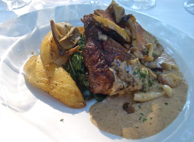 Sirloin steak with wild mushroom sauce and spinach and pine nuts