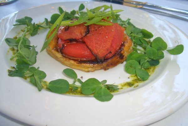 A puff pastry base with fontina cheese, dijon mustard, fresh basil and sundried tomato paste garnished with spring onion