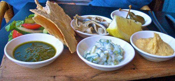 White anchovies with flatbreads and dips