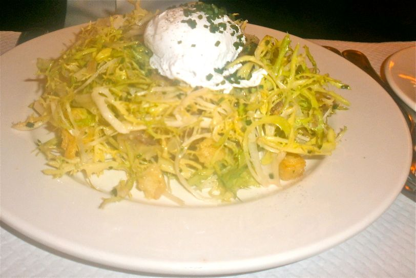 Chicory salad with a warm bacon shallot vinaigrette and a soft poached egg