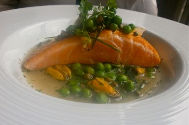 Cured salmon with monks beard, peas, caper and mussel broth