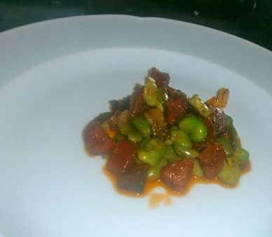 The delicious bed of onions, chorizo and broad beans
