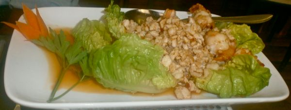 Spicy prawns and chicken served with lettuce leaves