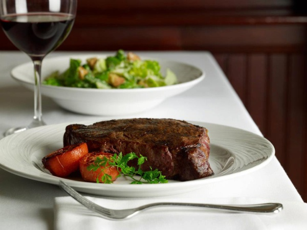 An amazing steak and a classic Caesar salad