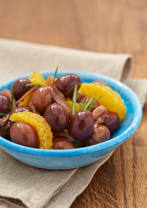 Black olives with anchovies, oranges and rosemary