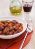 Chicken stew with tomatoes, chorizo and black olives