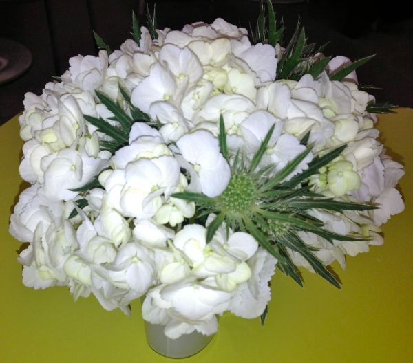 Beautiful bunches of white flowers on our lime green table